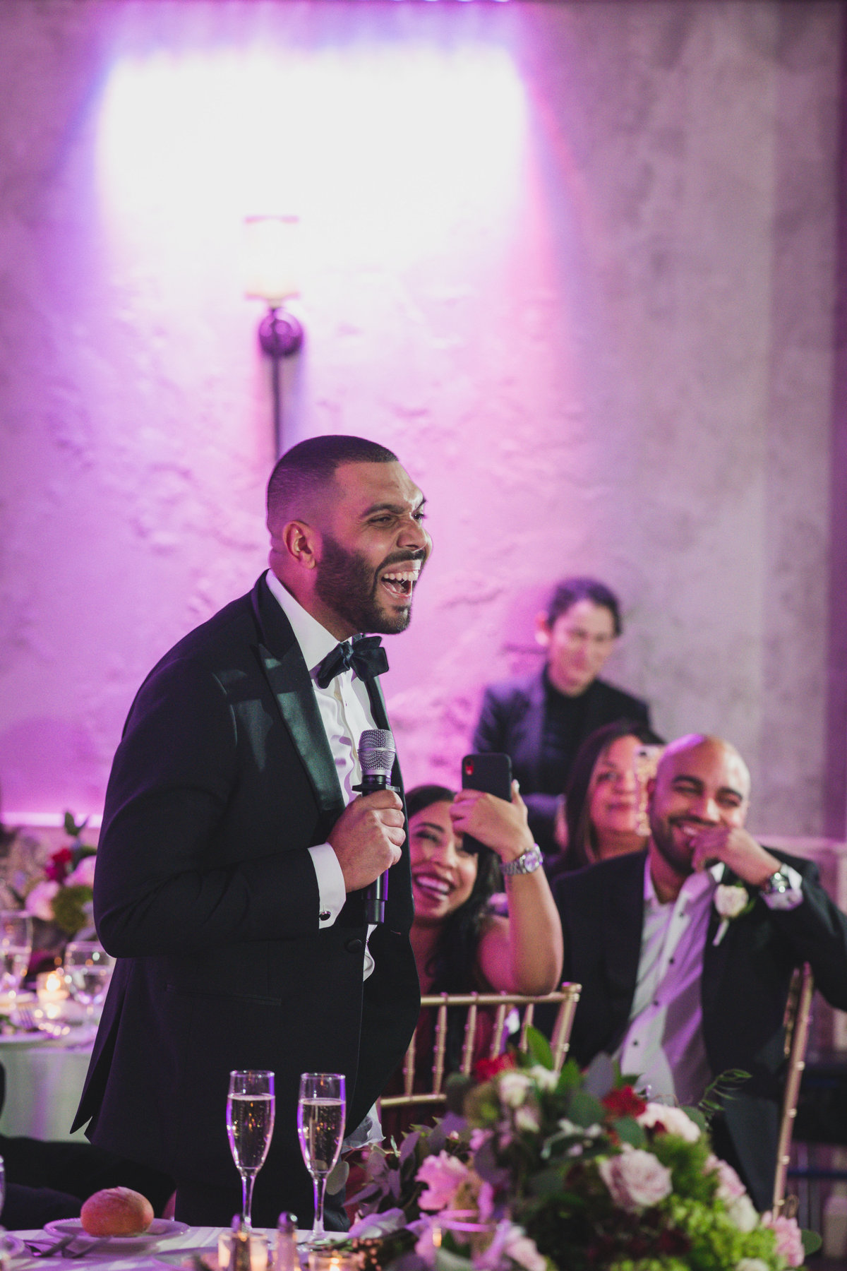 best man laughing while giving his speech at wedding reception at The Loft by Bridgeview