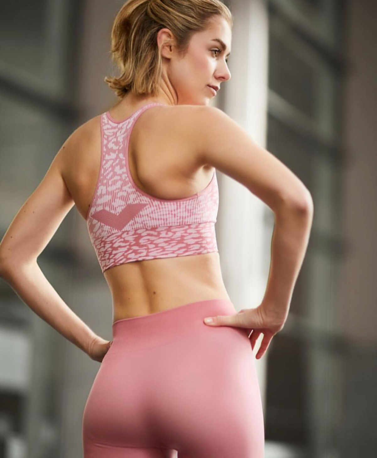 woman wearing pink fitness attire
