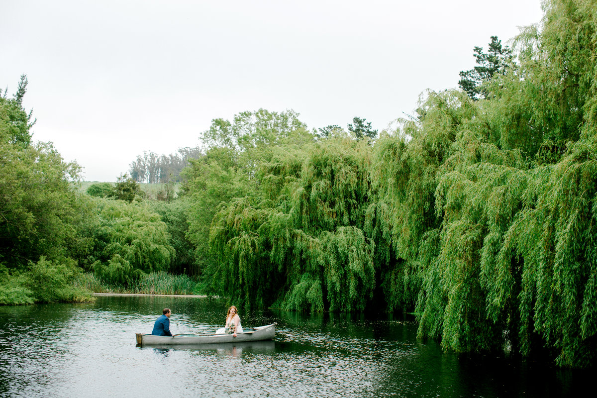 Bride and groom in canoe at Olympias Valley Estate in Petaluma California