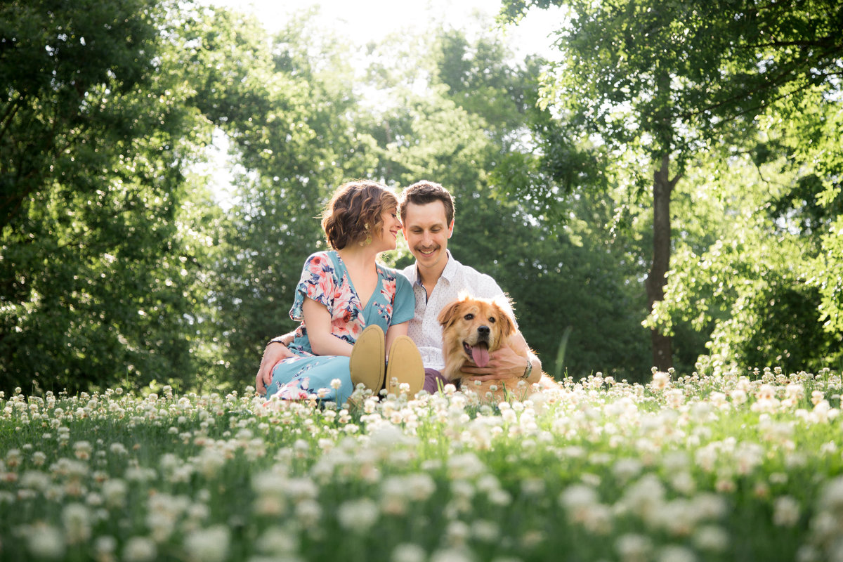 photo of engaged couple with dog  at park in Atlanta Georgia