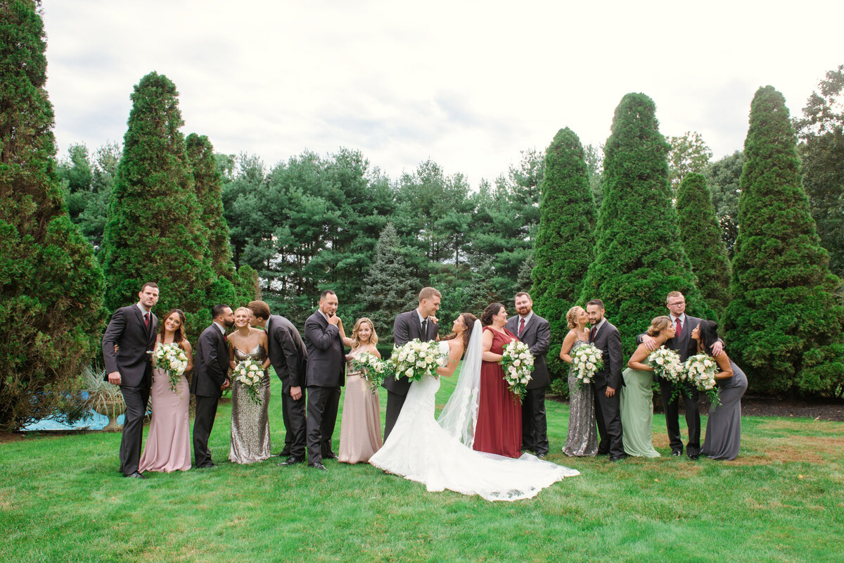 photo of bridal party with bride and groom outdoors from wedding at The Carltun