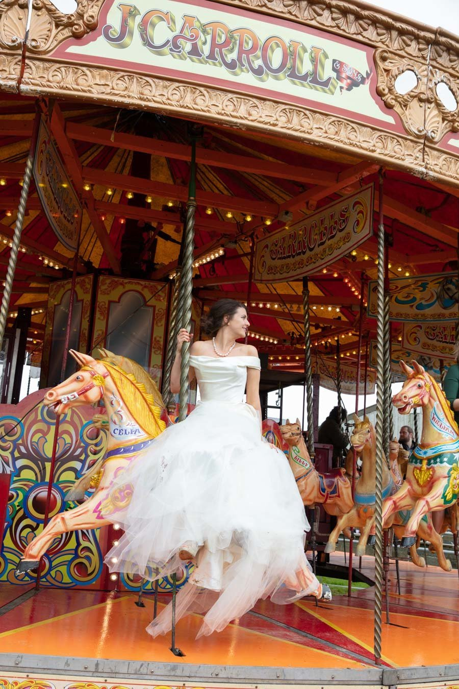 Bride on a fairground ride at The Barn South Milton