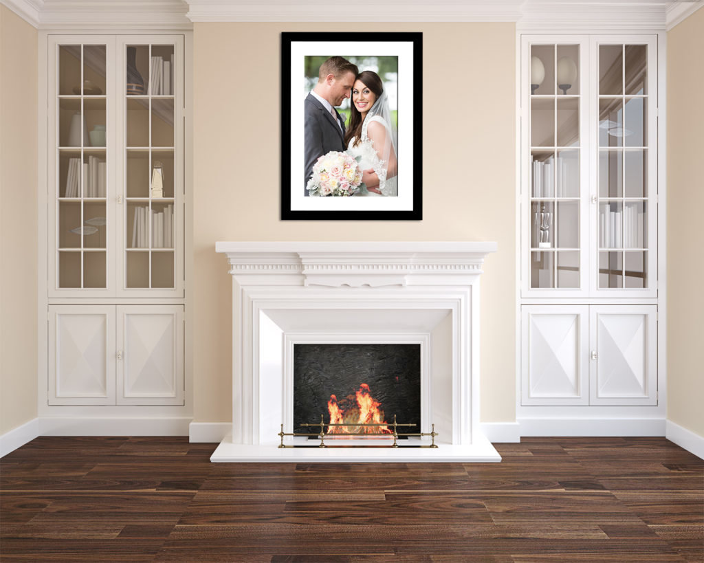 wedding portrait framed above a fireplace