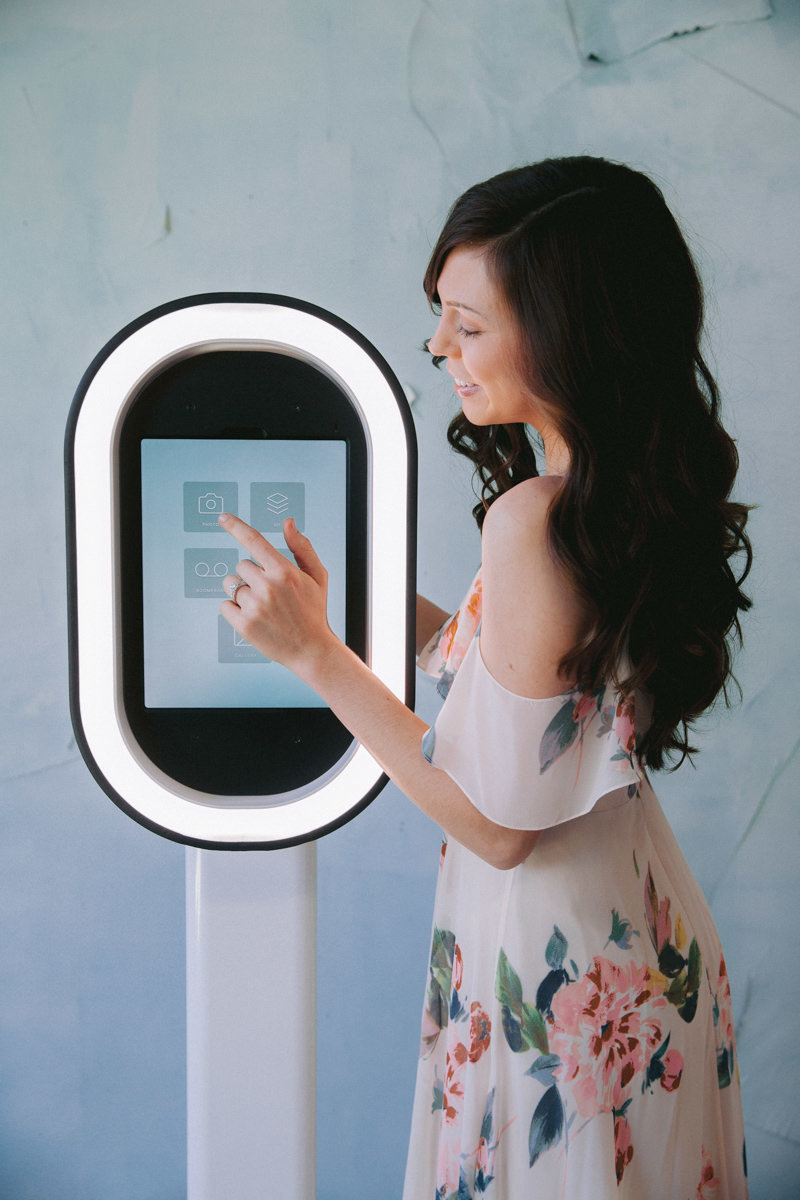A woman using a photobooth.
