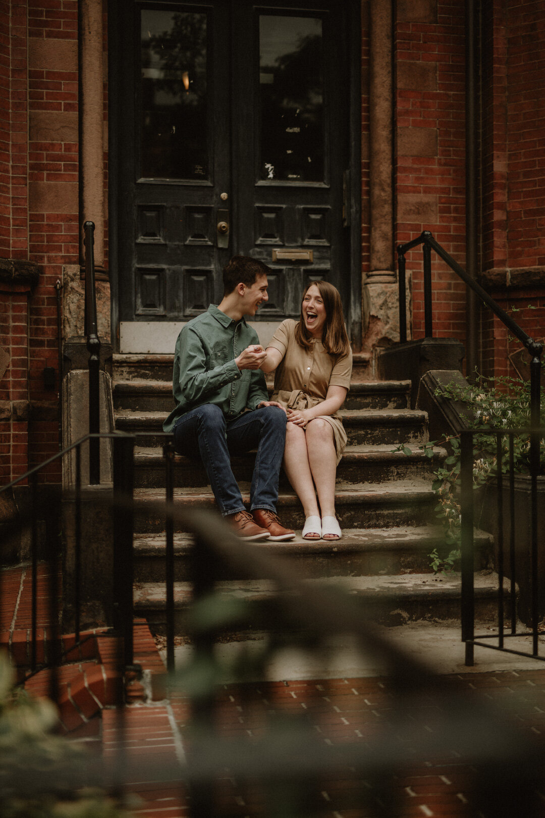 Earthy photo of couple sitting on doorstep | Jamie Tobin Photography