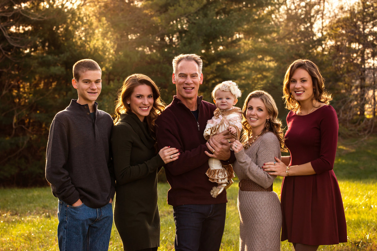Family portrait photography is beautiful when done outdoors in the fall