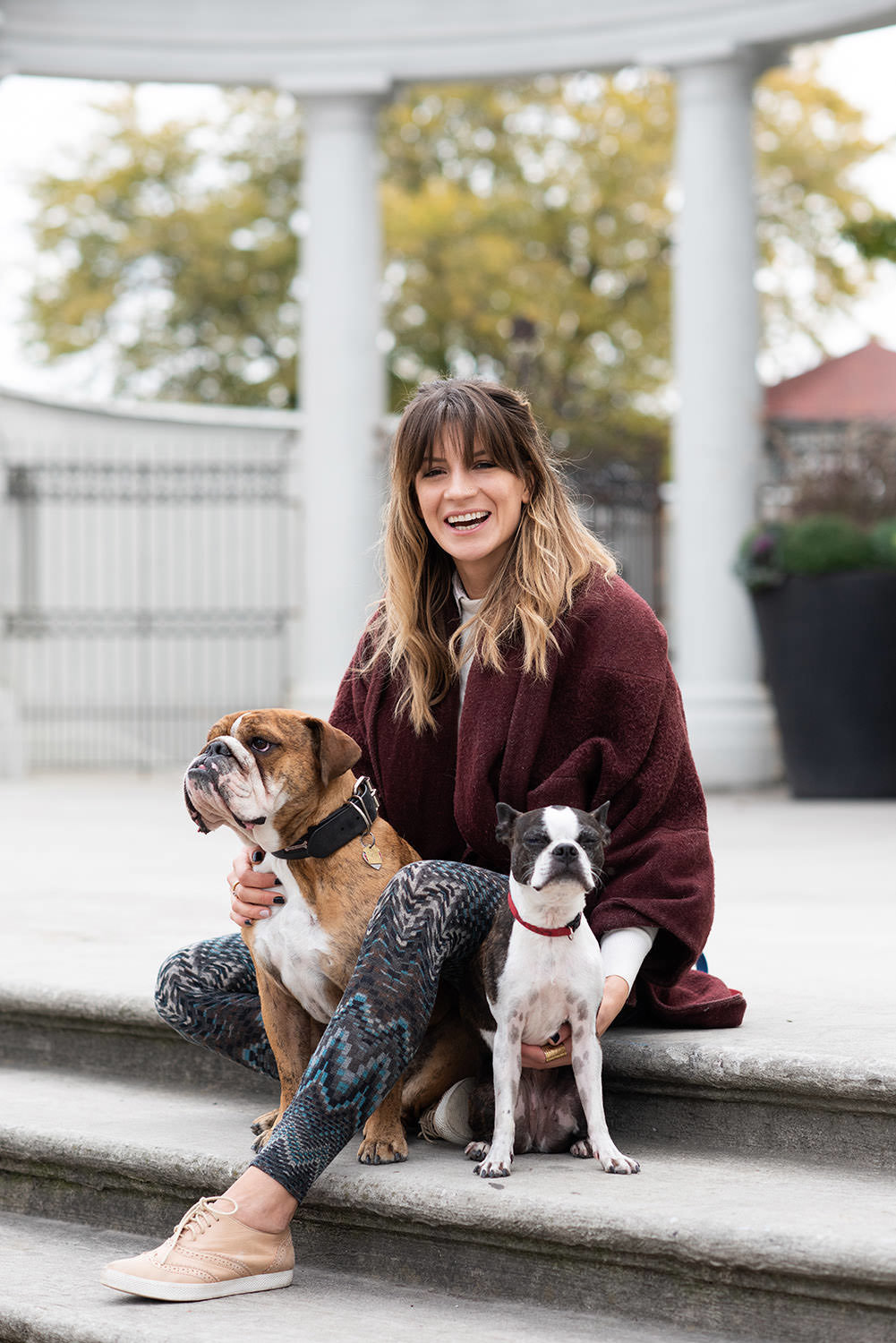 woman posing with two dogs