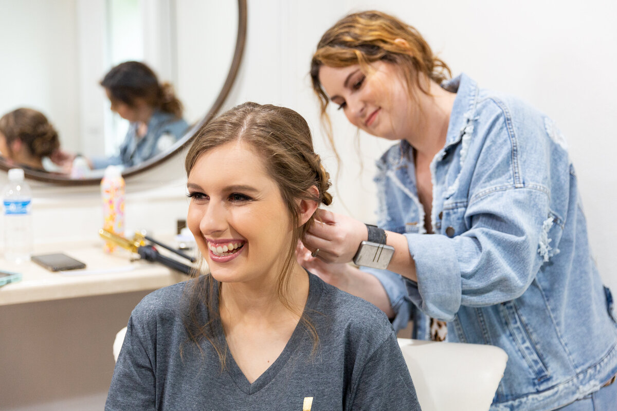 Bride Enjoying Spending Time with Her Friends During Hair & Makeup