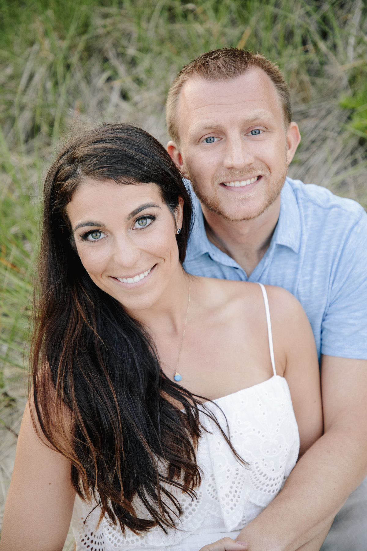 engaged couple on beach in manasquan