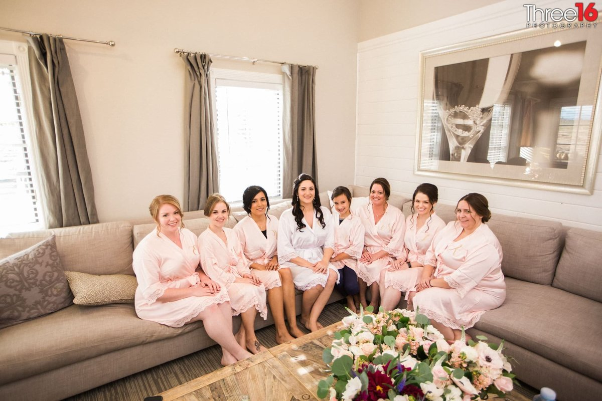 Bride and her Bridesmaids wearing their robes prior to getting ready for the ceremony