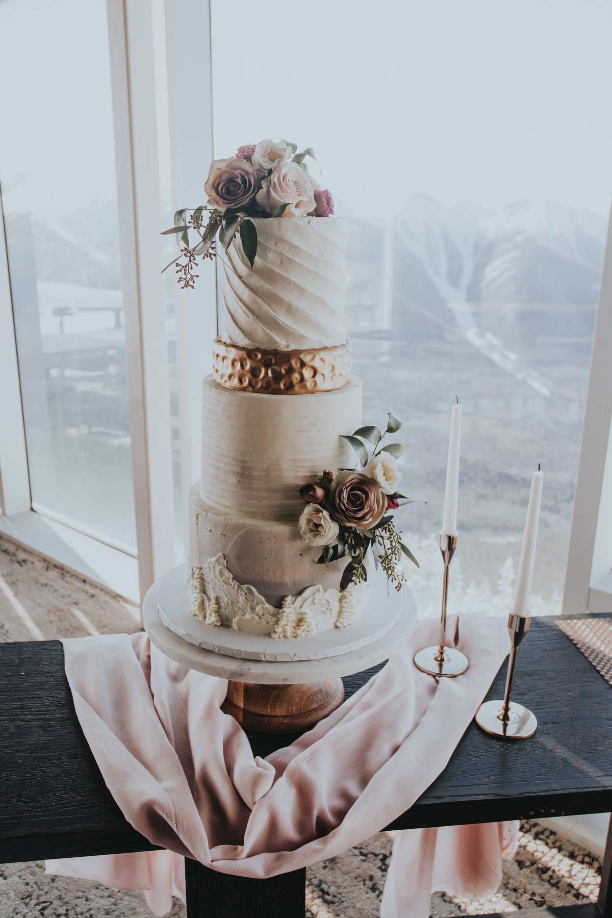 stunning mountain themed cake capture by Twenty Twenty Photography in Sky Bistro, cake designed by Bake My Day based out of Calgary