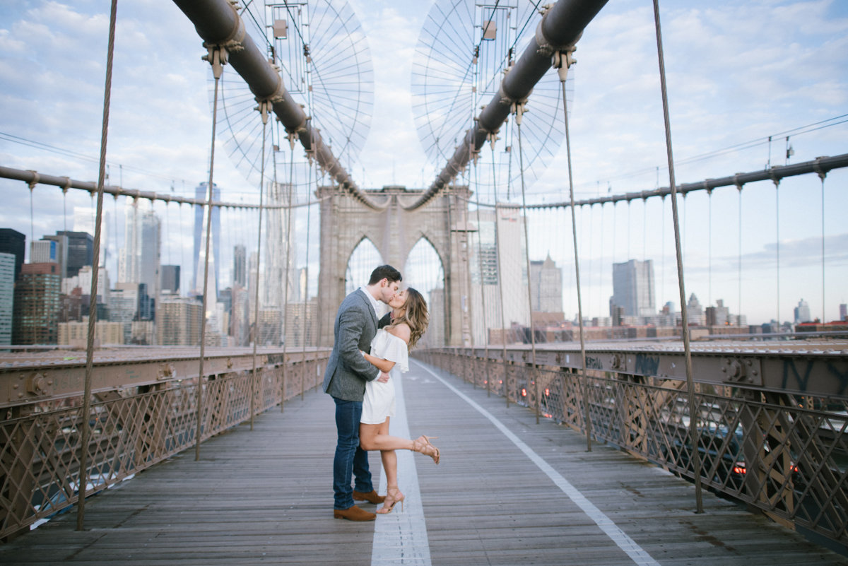 nyc engagement session brooklyn bridge kiss candid nyc ny new york skyline candid