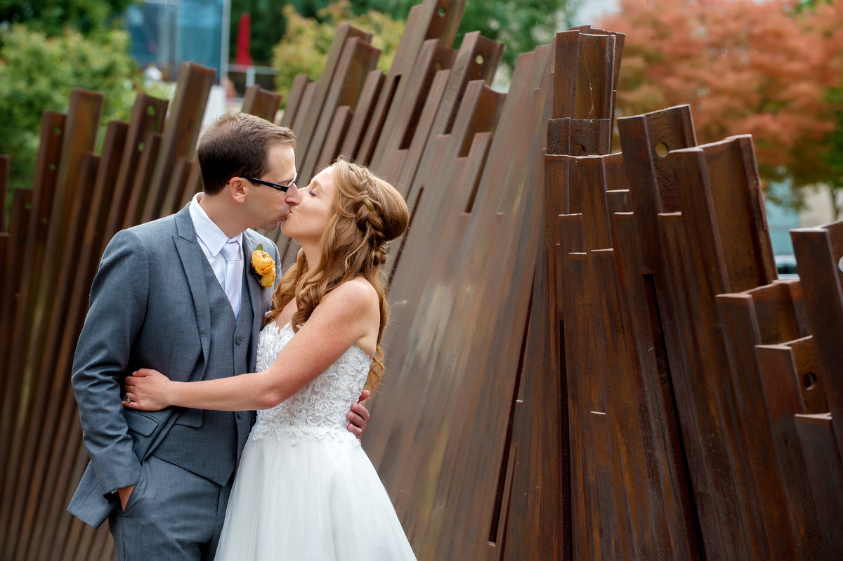 bride and groom kiss at tanner springs park