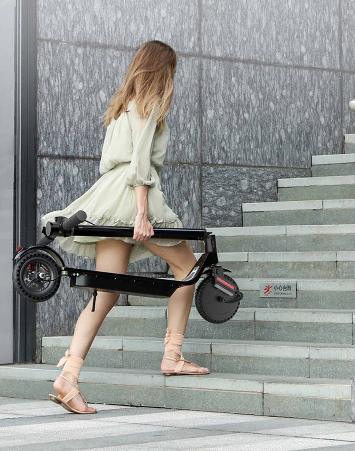 Lady walking upstairs on Scoot E-4