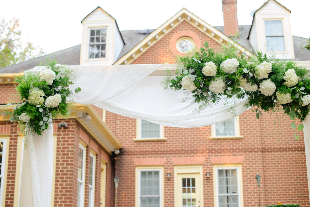floral wedding arch at eden try in fredericksburg va