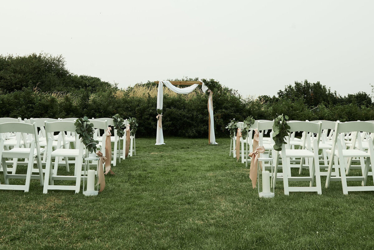 white-blush-greenery-wedding-arch