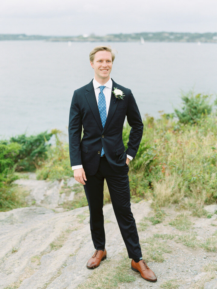 groom standing at newport castle hill inn