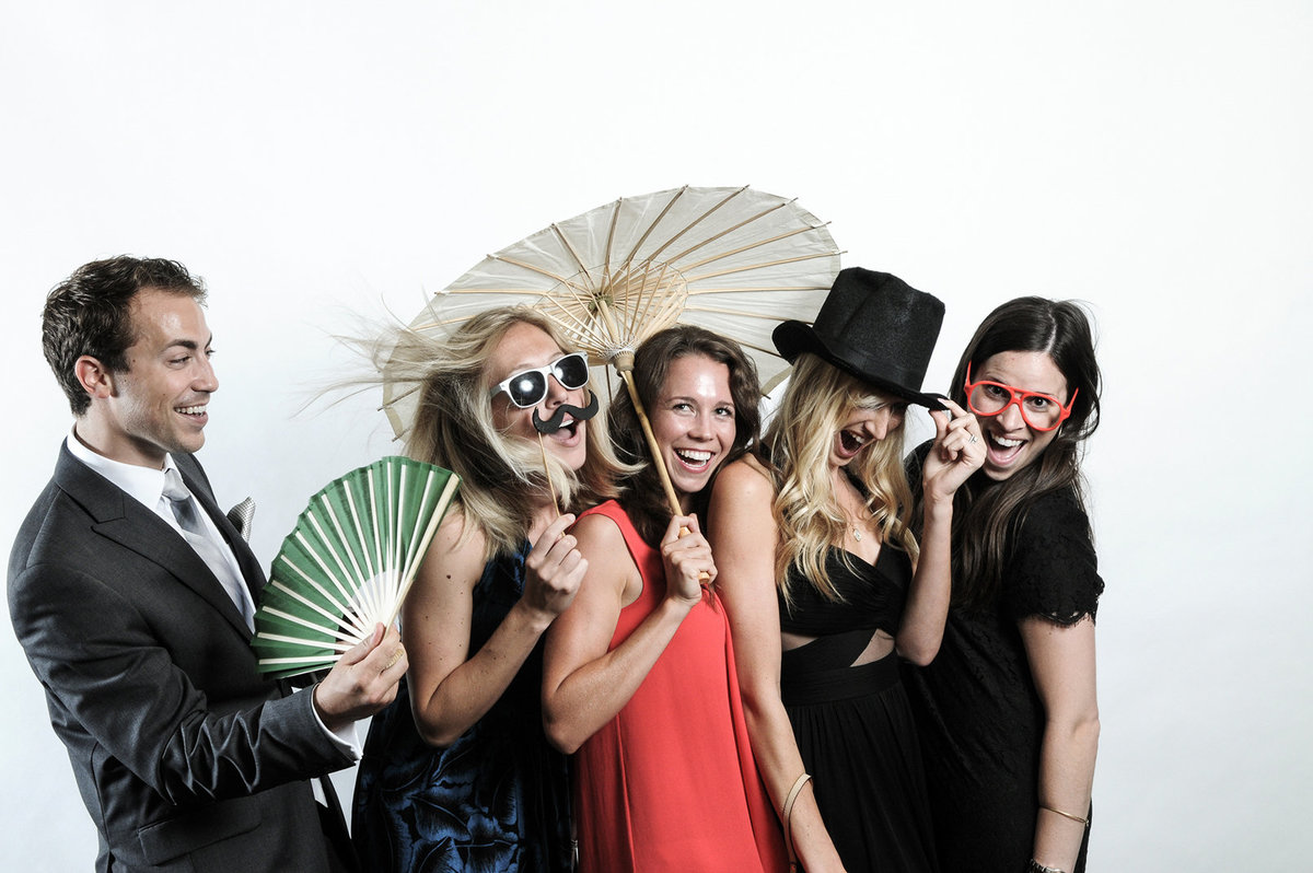 0013-Photo-Booth-Rental-at-Wedding-Reception-Guests-Having-Fun