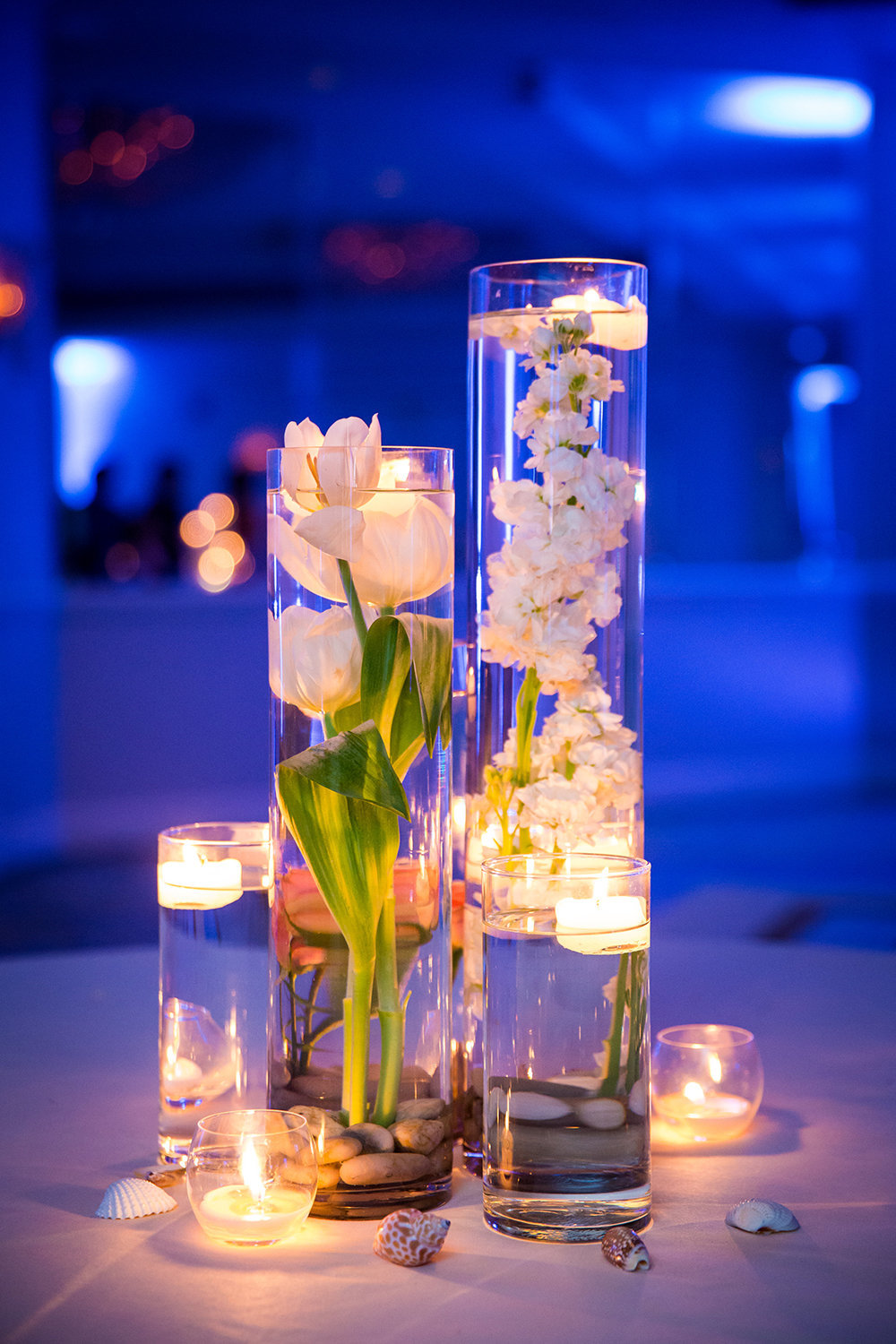 wedding photos candles with flowers floating in water