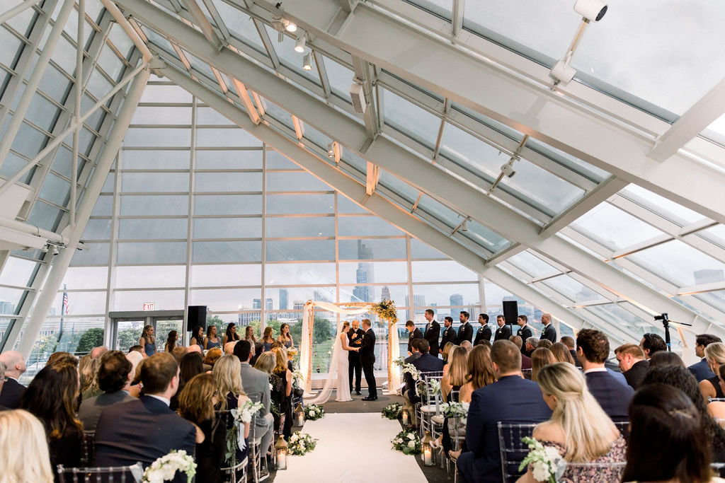 bride and groom marrying at the adler planetarium,