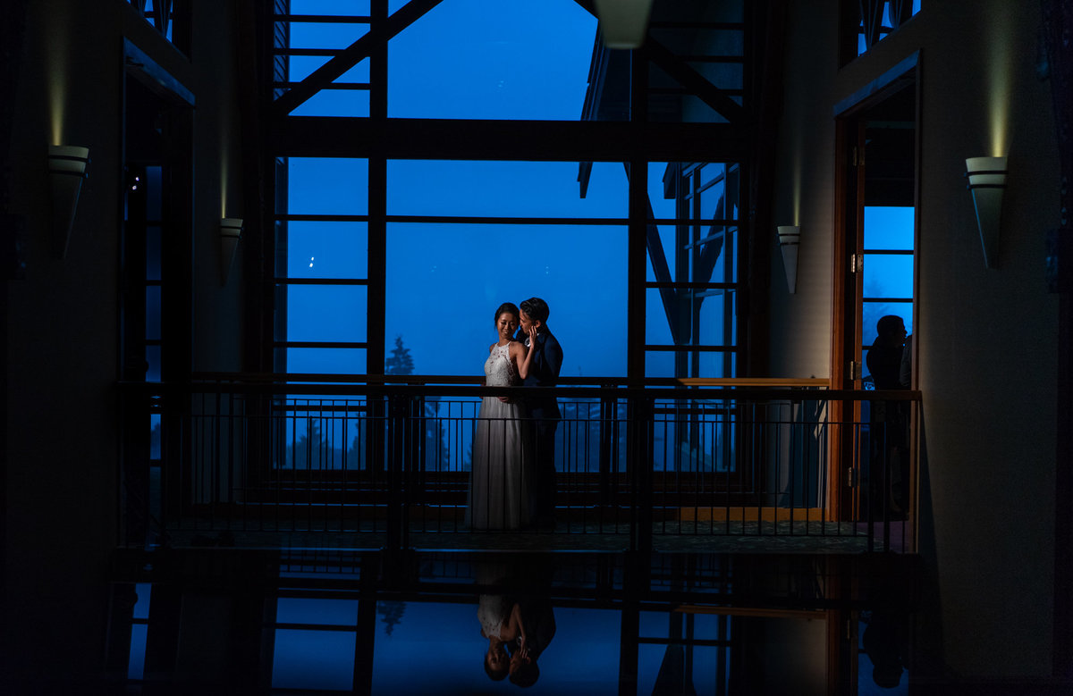 Westwood Plateau Golf Club wedding. Dramatic photo of bride and groom
