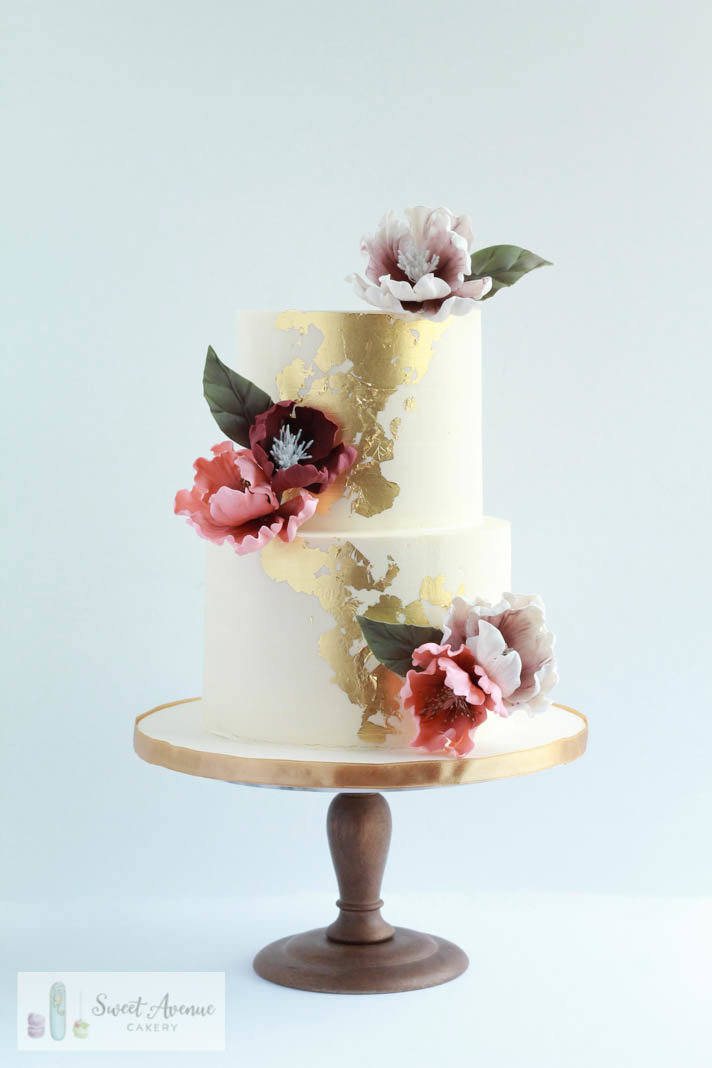 white wedding cake with gold leaf and sugar peonies