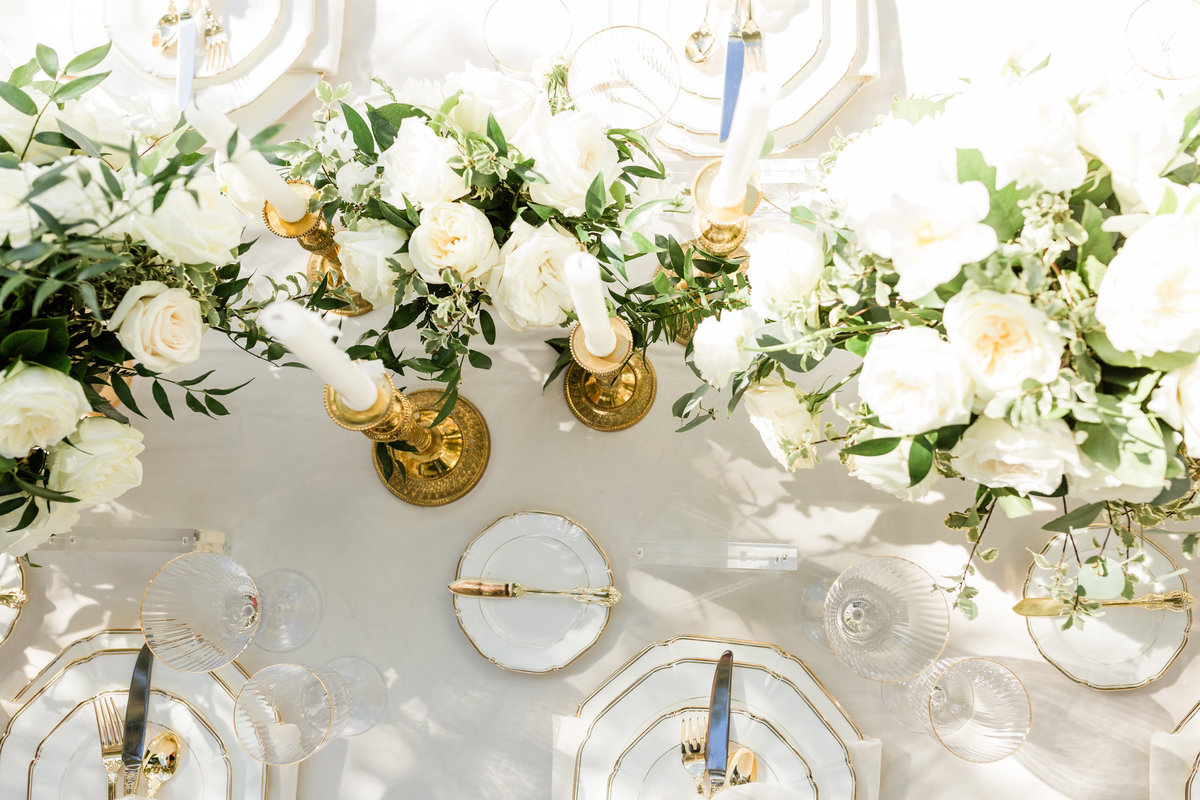 white and gold wedding reception tablescape