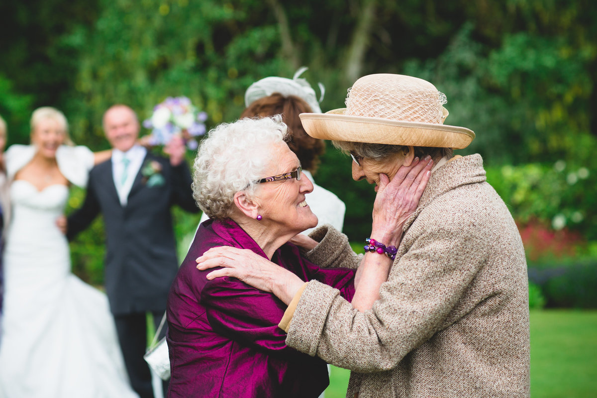 grandmas excited oon the wedding day hugging each other