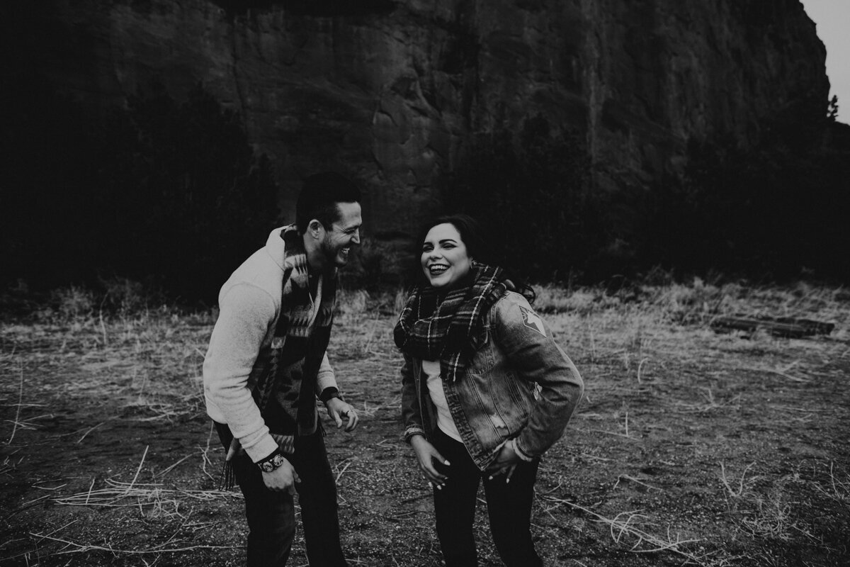 engaged couple laughing together in New Mexico desert