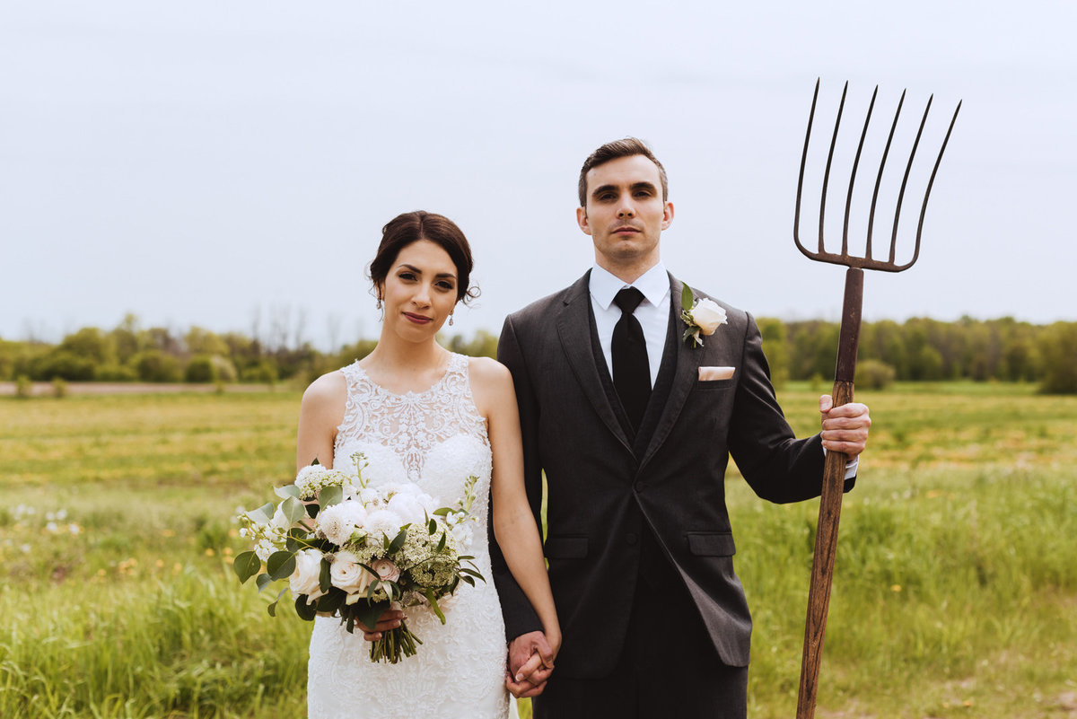 American Gothic reenactment at outdoor wedding