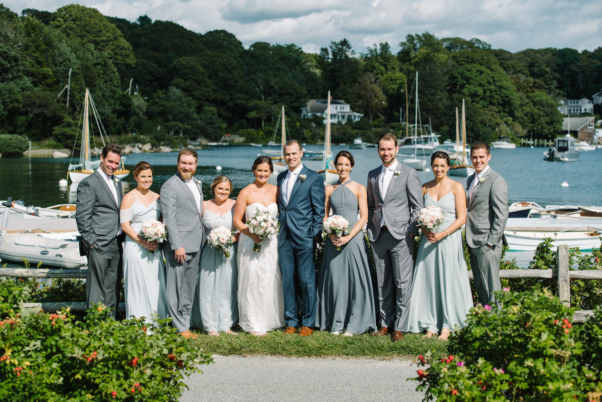 Bridal party with boats in background