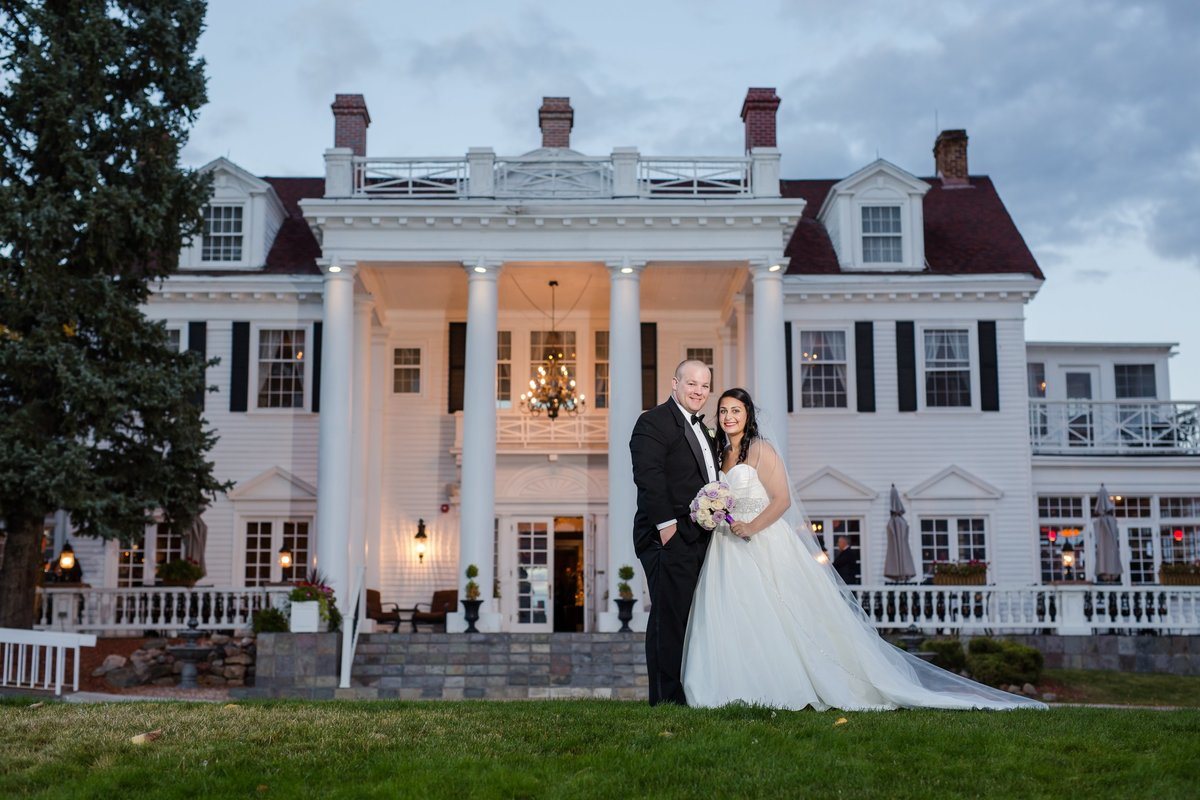 wedding couple in front of The Manor House
