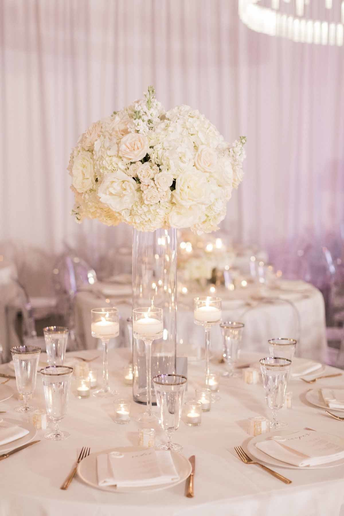 Such a romantic and soft look of all white roses  and hydrangea paired with tons of candles!