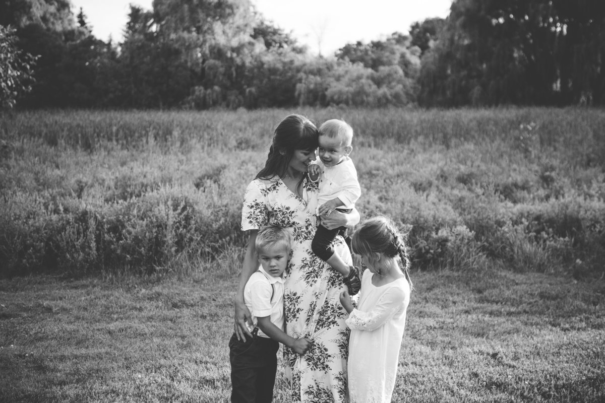 Mother interacting with 3 children in field {Oakville Family Photographer}