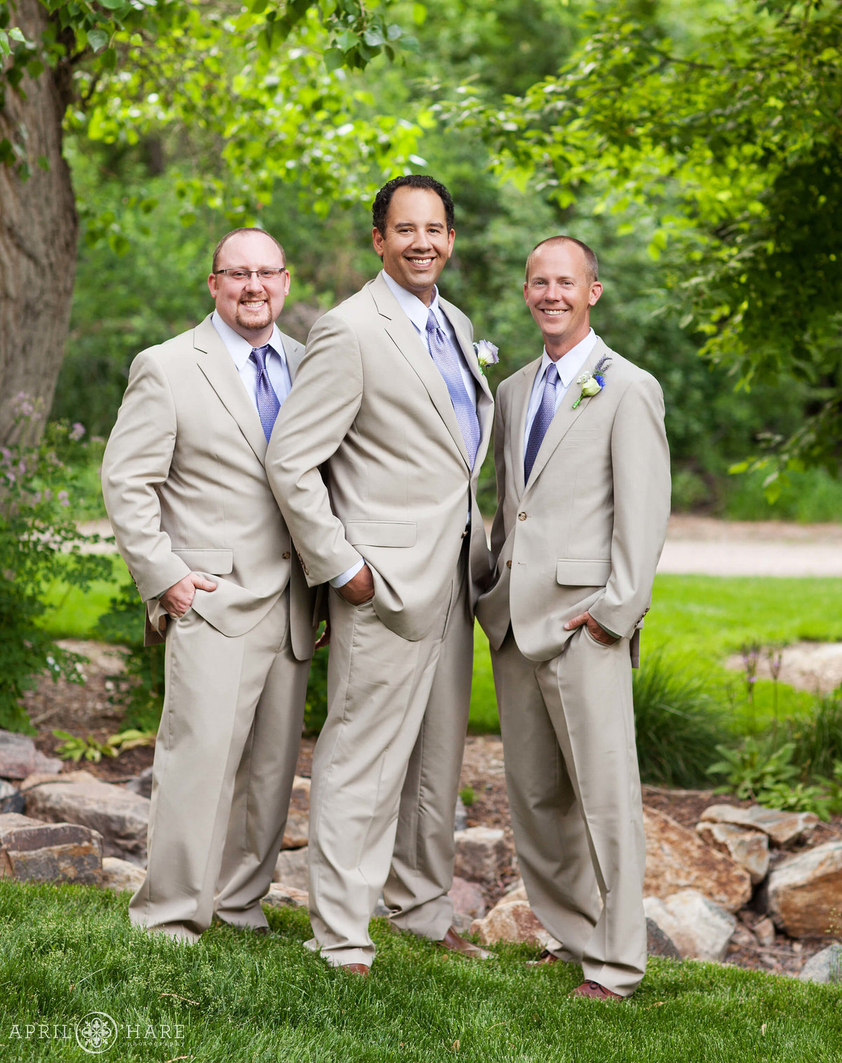 Groom wearing tan suit at Chatfield Farms Denver Botanic Gardens