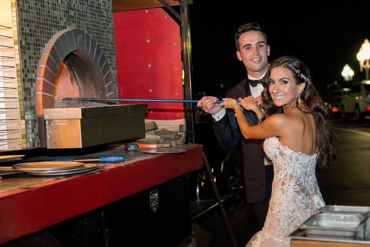 Bride and groom making pizza at Giorgio's Baiting Hollow