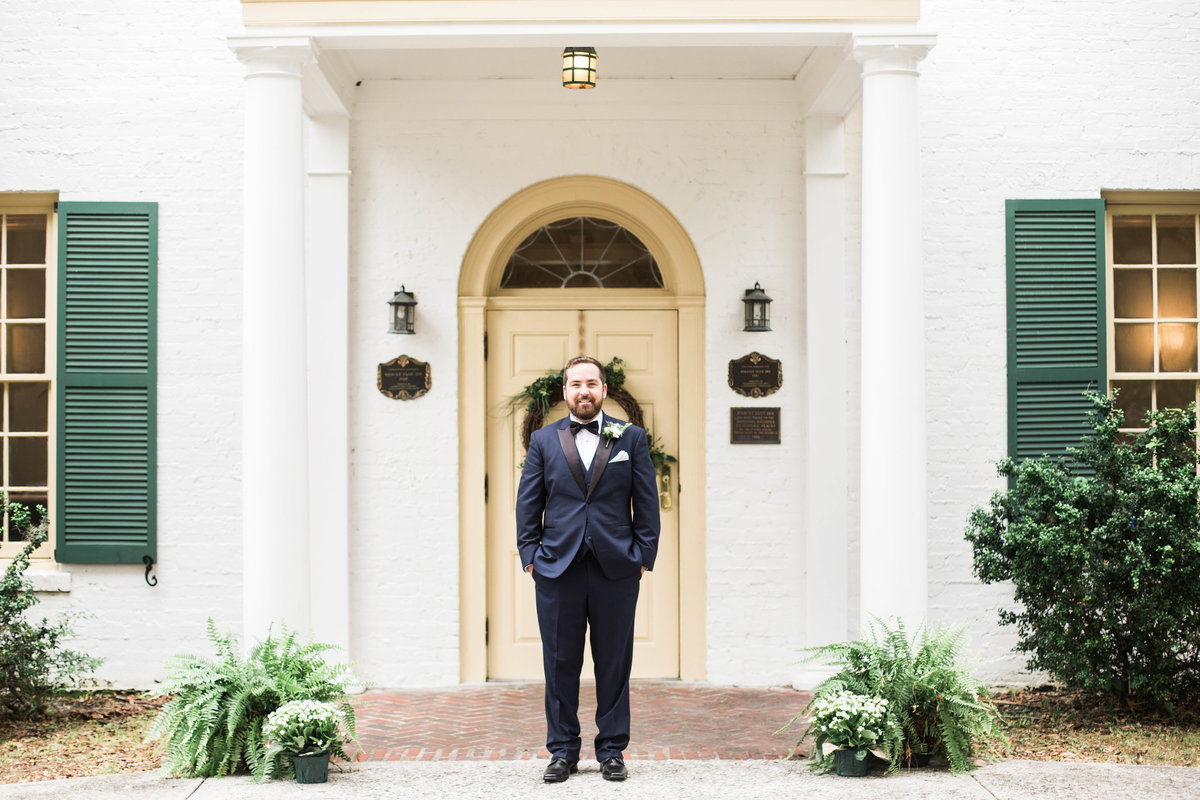 Groom Standing In Front of Ribault Club
