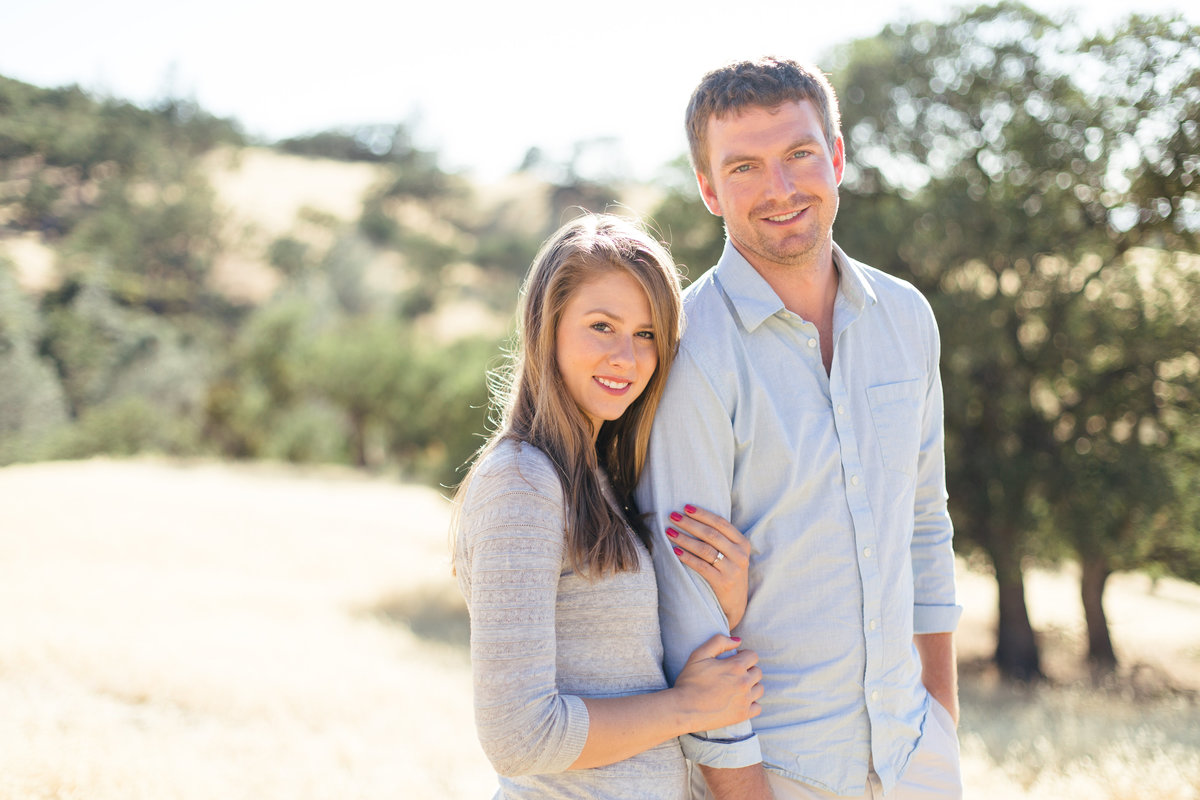 Couple pose after proposal in the Santa Ynez Mountains