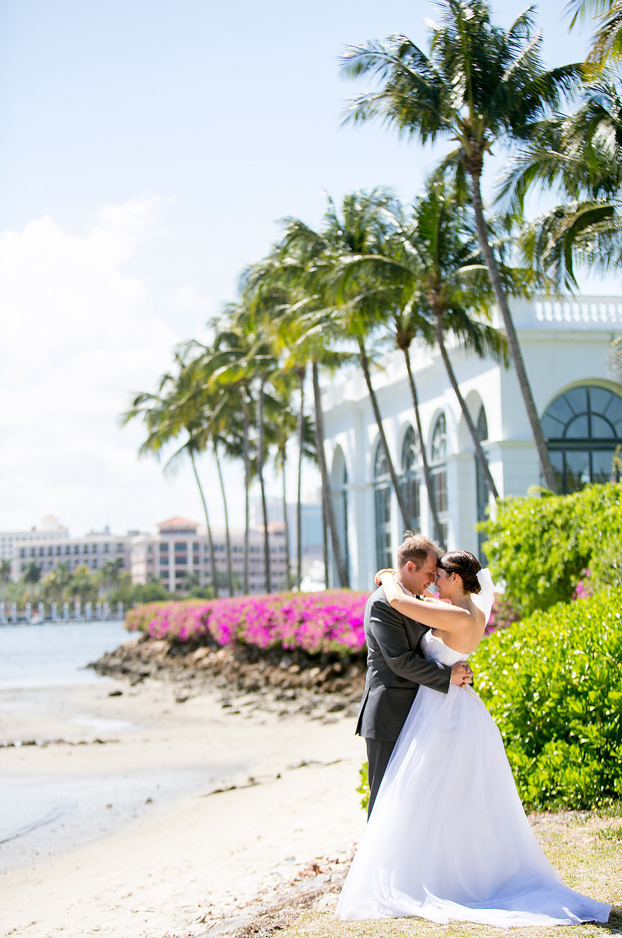 flagler museum wedding couple out by water
