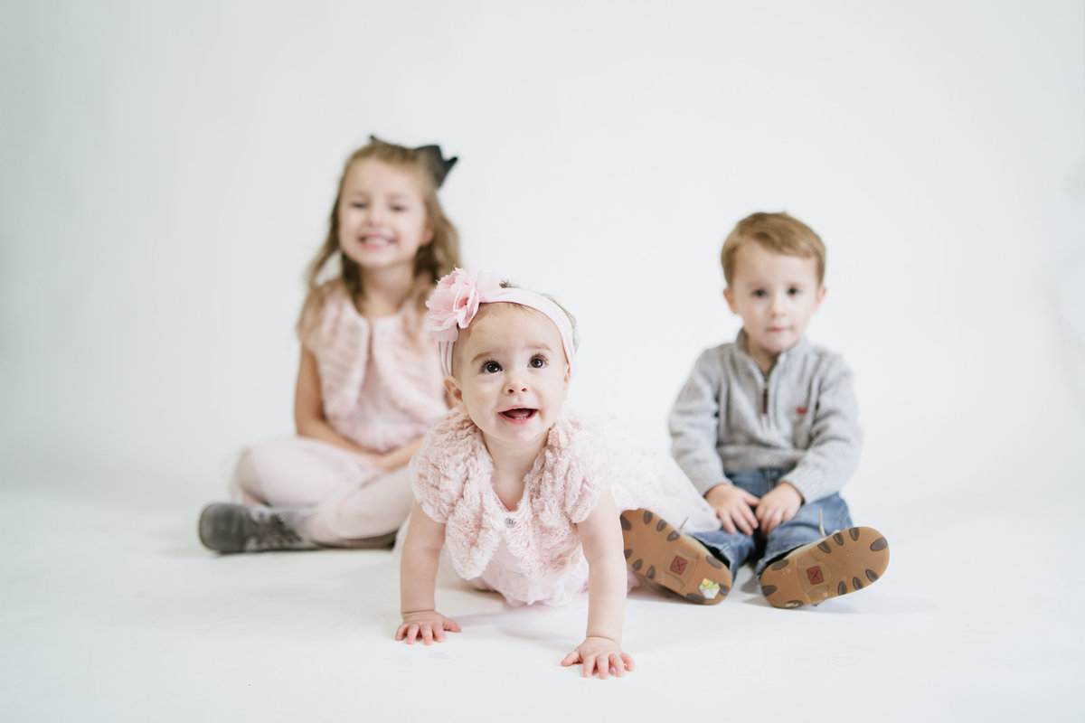 children studio portrait session on white background taken by San Antonio Photographer Expose The Heart Photography