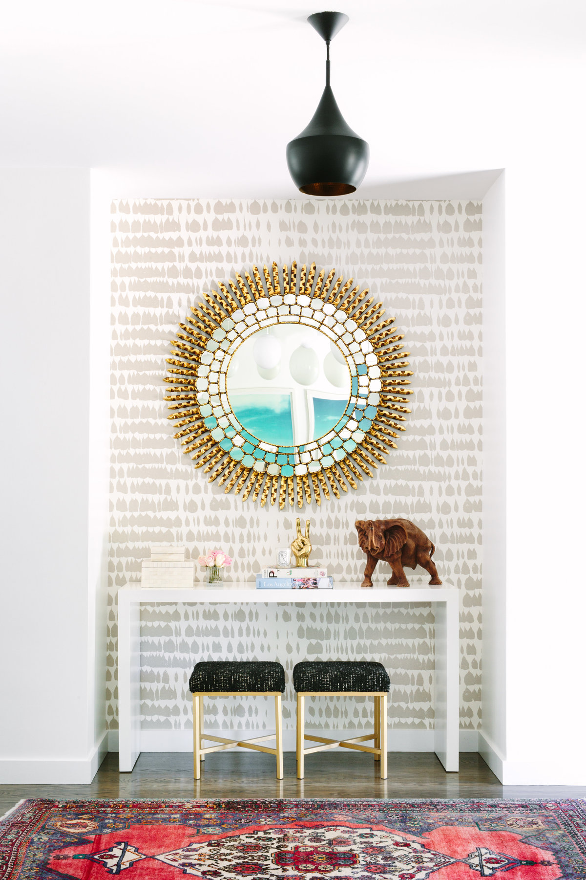 Entryway with Schumacher Queen of Spain wallpaper, Priley Lane Sutton console,Nior brass peace sign, and Beat Pendant