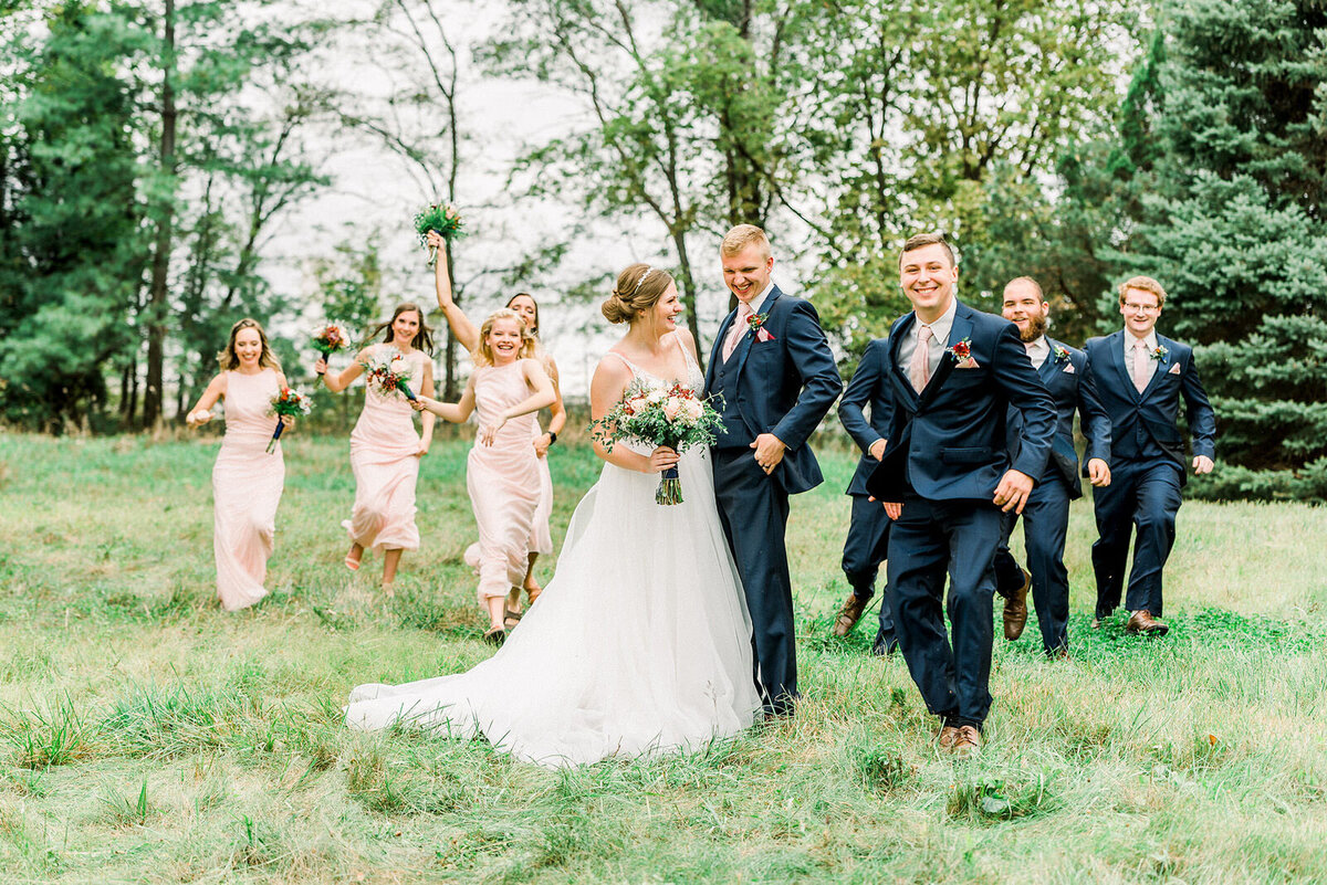 a wedding party has fun at pioneers park