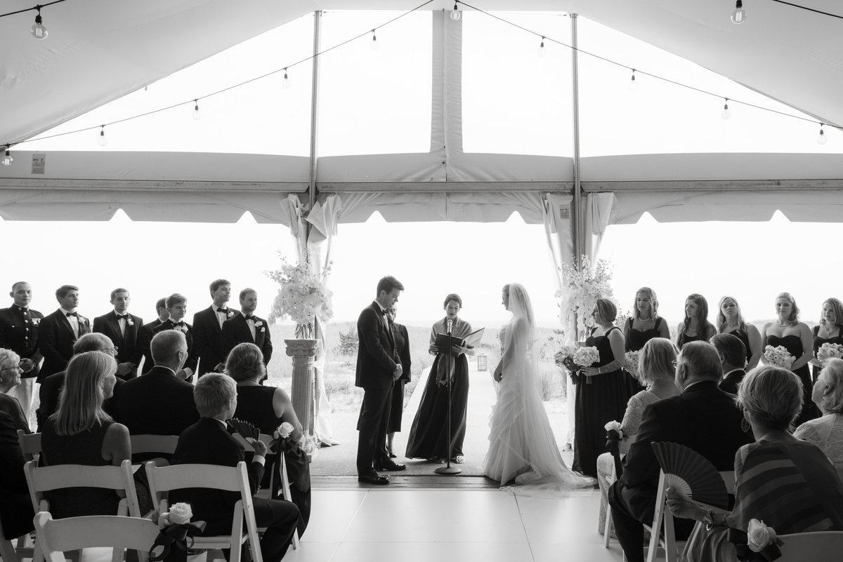 Black and white photo of wedding ceremony at Oceanbleu indoors