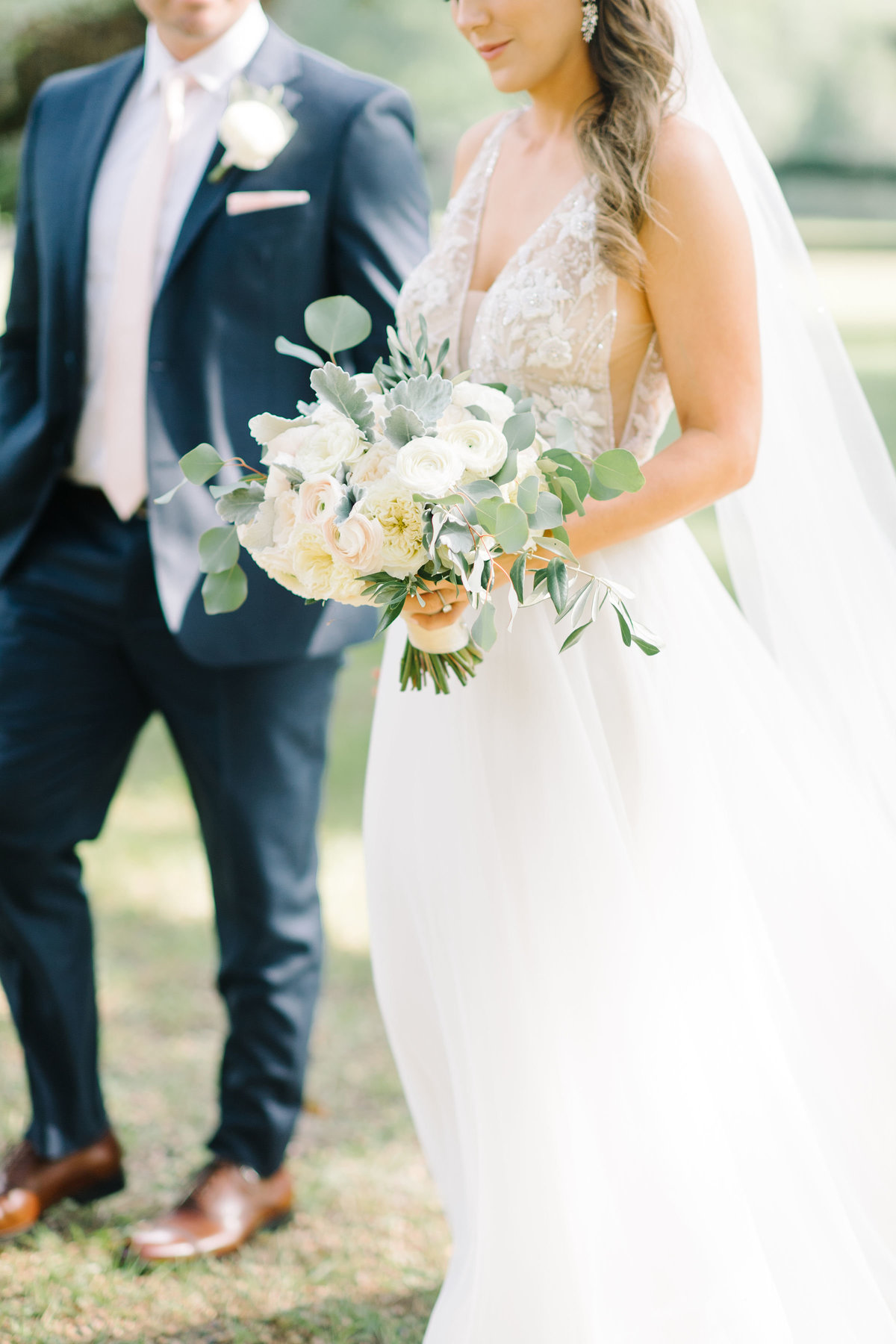 Bride with blush ivory greenery bouquet with Groom in Navy blue suit