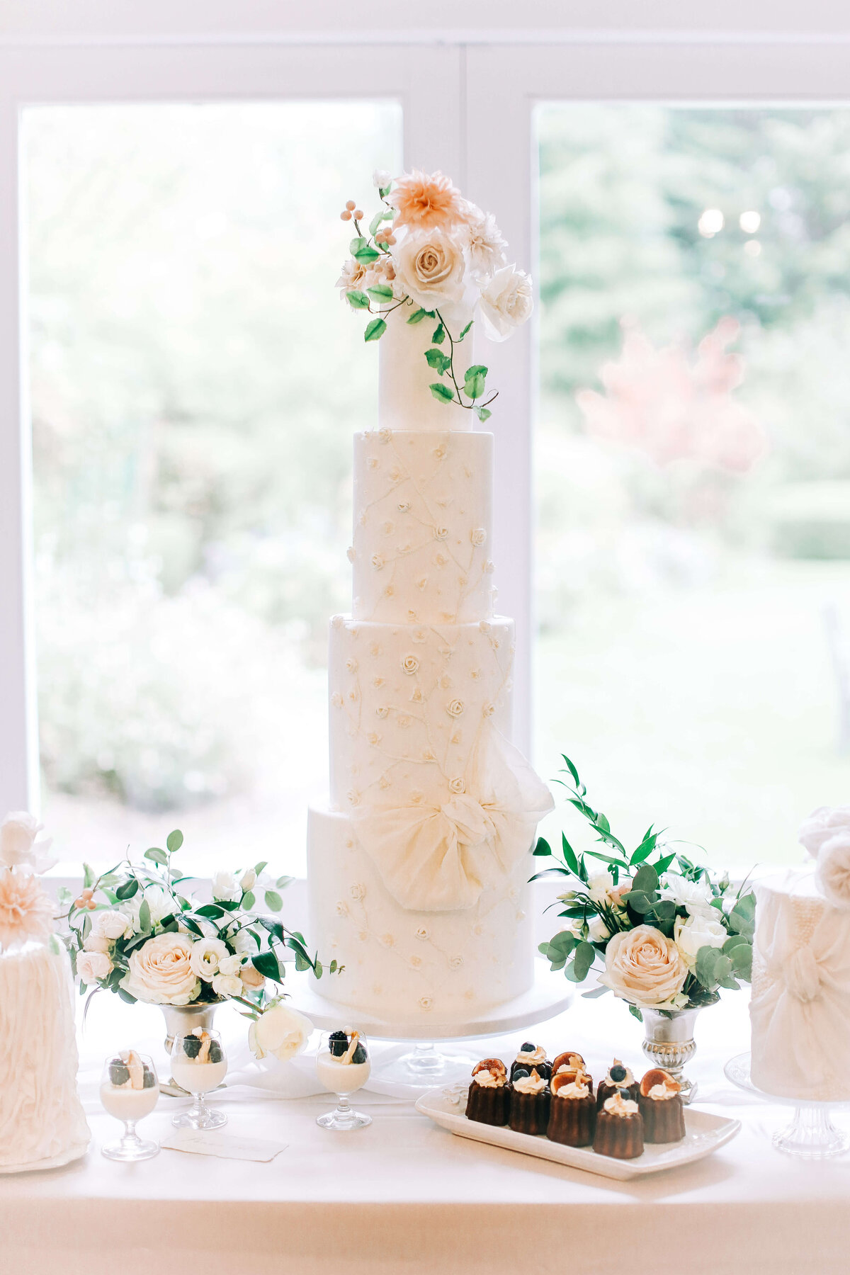 4 tier white wedding cake with bow and flowers  | MonAnnie