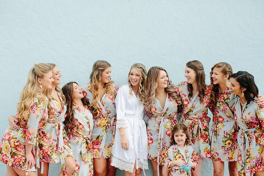bridesmaids wearing floral robes
