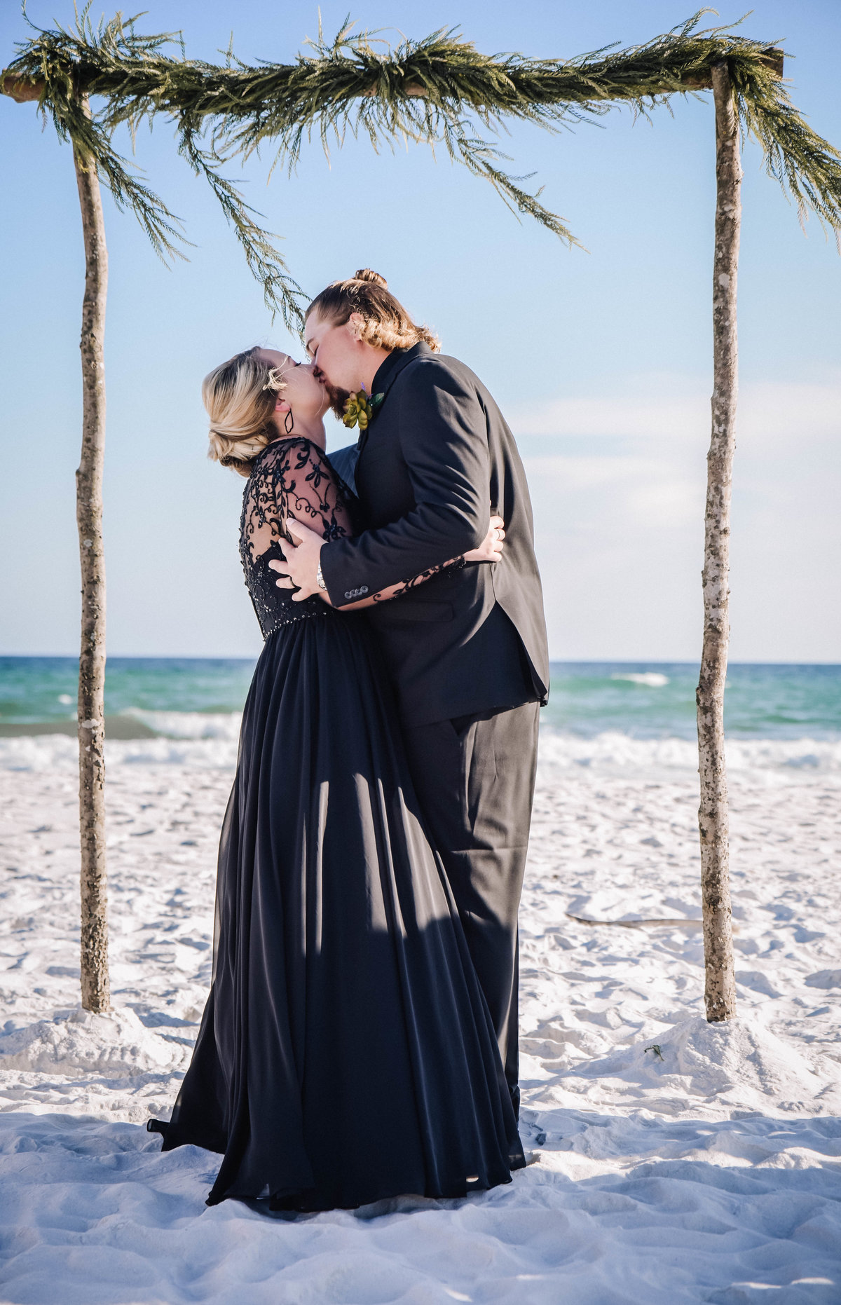 Bride and groom kissing on Pensacola Beach, Florida