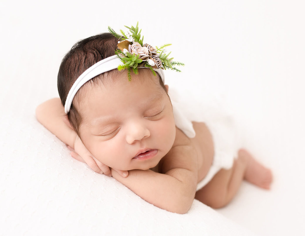 Newborn girl posed at our studio in Greece, Ny.