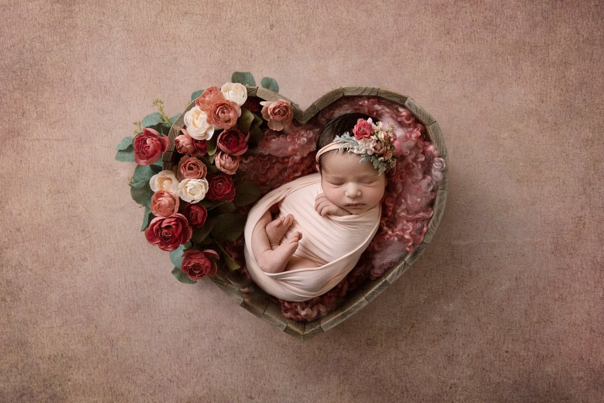 Little girl in a heart bowl
