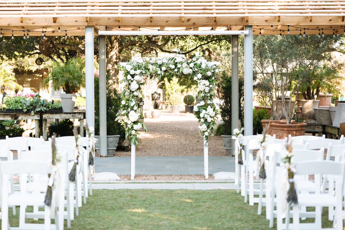 wedding ceremony at tiny boxwoods in houston, texas with destination wedding photographer smith house photo